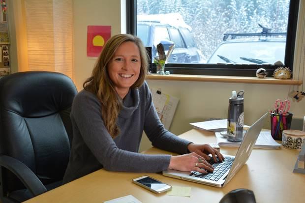 women working at laptop on office desk